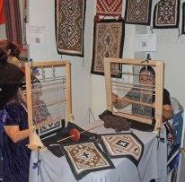 Barbara Ornelas and Lynda Pete from Navajo Nation weaving