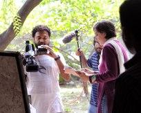 Film crew interviewing Surayia.