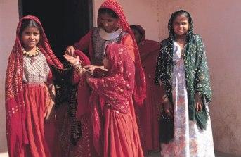 Jat girls wearing traditional bandhani clothing for a ceremony. Photo courtesy Zakiya Adil Khatri.