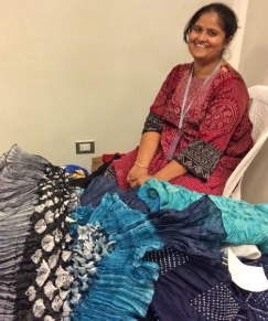 Zakiya in her display booth at Tinkuy. She opened up her suitcase and her bandhani scarves exploded out.