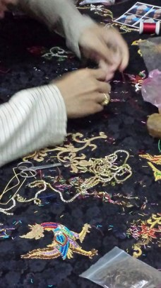Hand embroidery using gold thread.