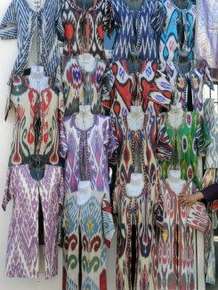 An array of ikat clothing for purchase at the Kum-Tep market.