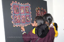 Young weavers take a closer look at competition entries.