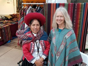 Nilda Callañaupa (wearing traditional dress) and ATA board member Jennifer Moore wearing a newly acquired woven poncho.