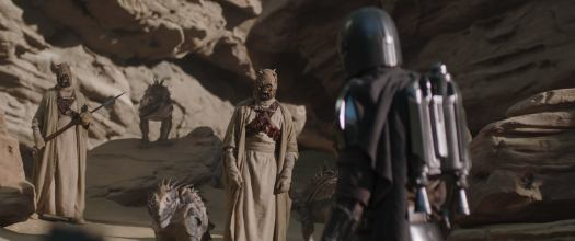Tusken Raiders and The Mandalorian (Pedro Pascal) in Chapter 9. (Photo credit: Lucasfilm Lt.)