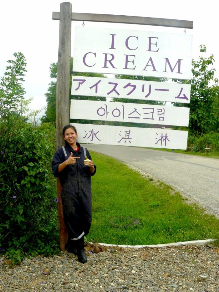 Saisamone Chittaphong, a calf specialist, stands in front of the ice cream locale with her favorite, caramel.