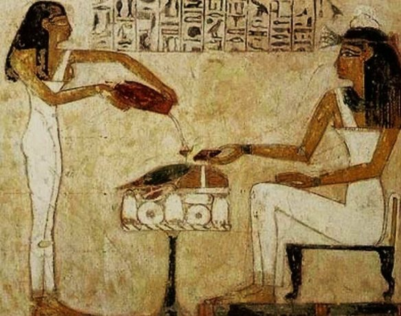 Egyptian hieroglyphics depict women pouring beer.