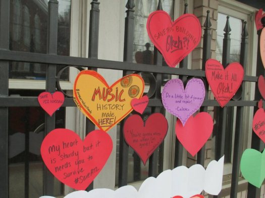 Supporters of the campaign to save 152 Nassau have been posting little paper hearts on the front of the building.