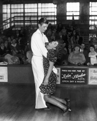 Frank Micholowsky holds his exhausted sister and dance partner, Marie Micholowsky, after a marathon dance competition.