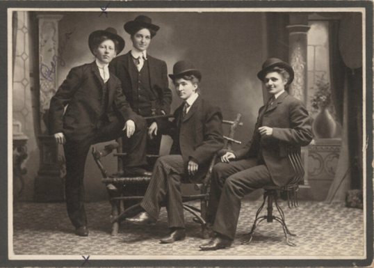 """This photo, taken on the Minnesota frontier, depicts Regina Sorenson and three others """"dressed in men's suits."""""""