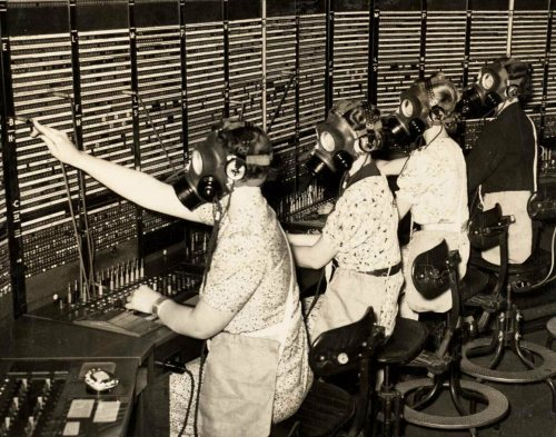 Gas mask training for switchboard operators, London, 1938.