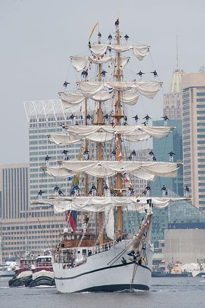 Ecuadorian cadets stand on the yardarms of the Guayas tall ship as it departs Baltimore on Tuesday.