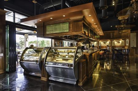 The cafe displays gelato and handcrafted desserts at the counter.