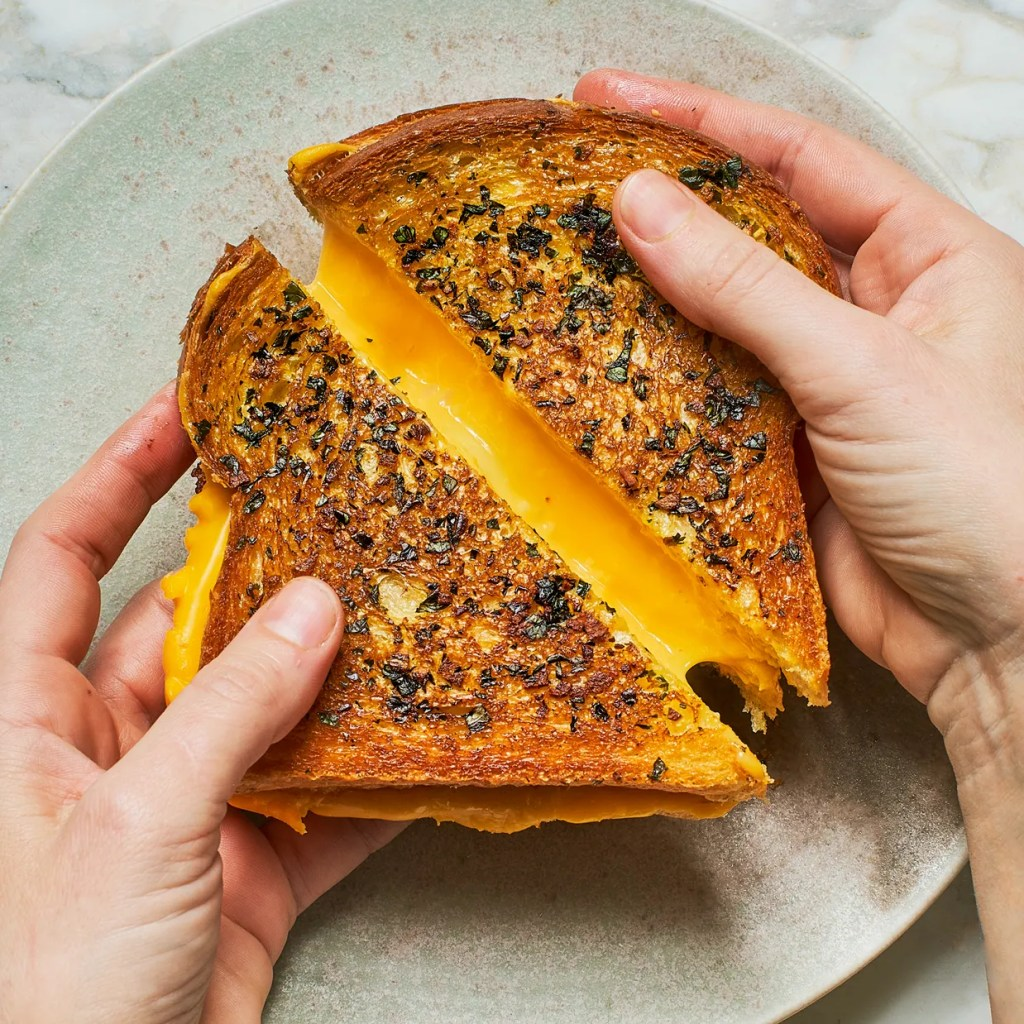Grilled cheese sandwiches have long been a favorite American comfort food. This version takes the ordinary grilled cheese sandwich to the next level