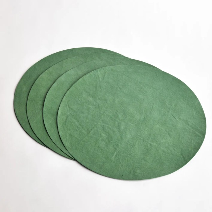 Four round placemats fanned out