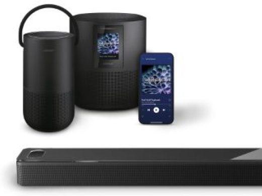 Bose Portable Smart Speaker, Bose Smart Speaker 500 and a Bose Smart Soundbar shown with a smartphone