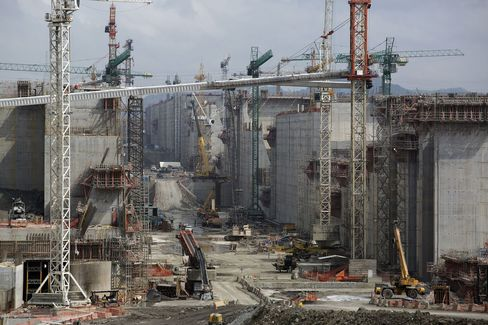Cranes stand at a construction site for the expansion of the the Panama Canal, on the Pacific side of the canal near Panama City on April, 24, 2014.