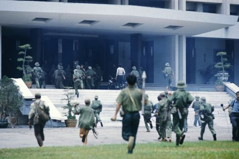 Communist troops attack the presidential palace in Saigon, marking the war's end on April 30, 1975.