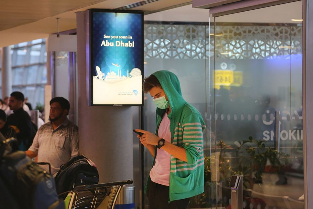 UAE Coronavirus News: Abu Dhabi Airport Shuts One Terminal - Bloomberg