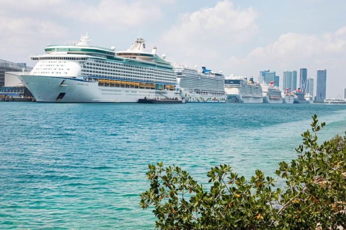 Florida, Port of Miami, Row of cruise ships docked, non-essential business due to Coronavirus