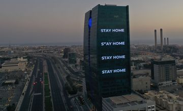 """Stay Home"" is displayed on a tower during the coronavirus pandemic in Jeddah."