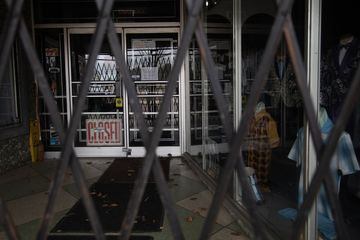 A security gate blocks the entrance to a closed store in downtown Flint, Michigan, on April 13.