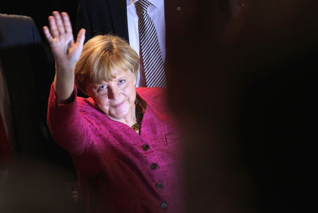 German Chancellor and Chairwoman of the German Christian Democrats (CDU) Angela Merkel waves as she departs after speaking at a CDU election rally the day before federal elections on September 21, 2013 in Berlin, Germany.