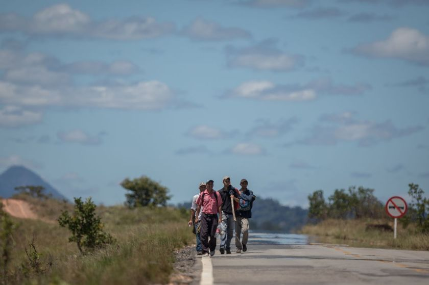 Venezuelans walk along BR 174 highway from Pacaraima to Boa Vista.
