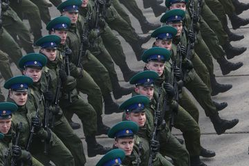 MOSCOW, RUSSIA - APRIL,11 (RUSSIA OUT)  Russian officers march during the Victory Day military parade rehearsals at Alabino polygon, 40 km. West of Moscow, Russia, April,11, 2016. 10 000 soldiers and officers, more than 100 tanks, armored carriers and other vehicules, 71 jets, bombers and other planes are taking part in the rehearsals of the Red Square military parade honour the 71-th anniversary of the victory of Soviet Union in the WWII.(Photo by Mikhail Svetlov/Getty Images)