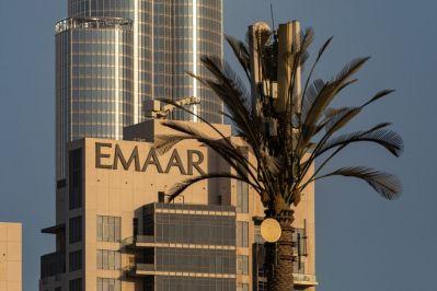 Emaar Properties PJSC logo on a building near the Burj Khalifa skyscraper in Dubai.