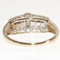 585/14 kt. yellow gold ring, set with 14 princess cut