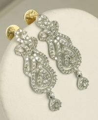 Set of gold necklace and long earrings with diamonds ...