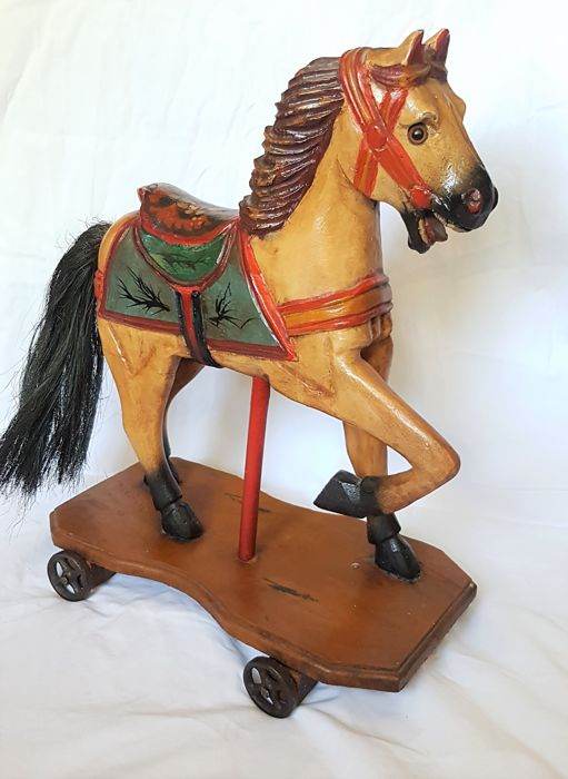 Antique decorative wooden horse on wheels. hand-painted - Catawiki