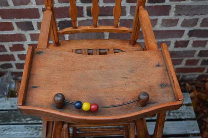 vintage wooden high chair that turns into a wood catawiki