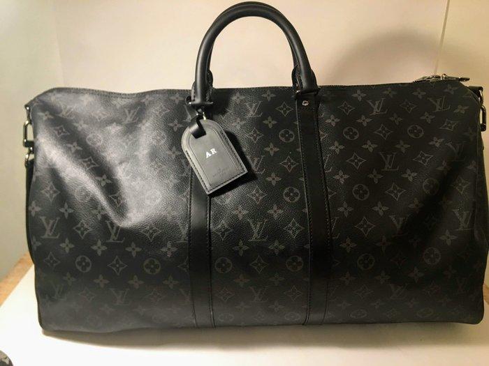 38e8296f9f1 Louis Vuitton Keepall Bandouliere 55 Travel Bag Catawiki