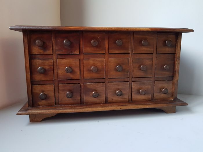 Vintage apothecary cabinet with eighteen drawers 2nd half