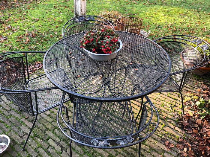 wrought iron patio set in the style of