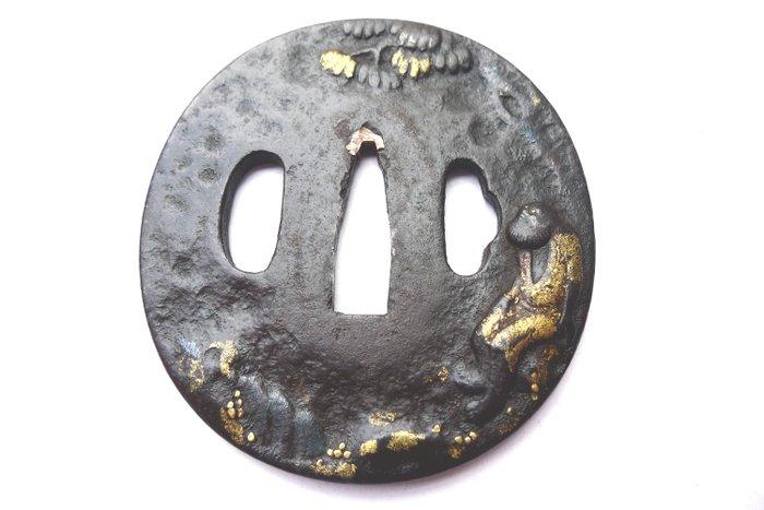 Beautiful gold inlay prehistoric man motif tsuba - Iron - Japan - Early Edo period