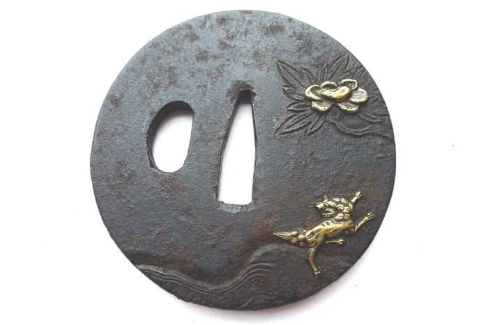 Japanese flower shi shi lion motif tsuba - Iron - Japan - Edo Period (1600-1868)