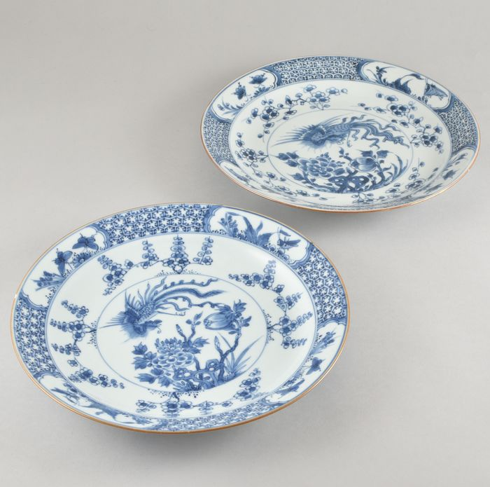 TWO BLUE AND WHITE DISHES DECORATED WITH A PHOENIX (2) - Porcelain - China - Kangxi (1662-1722)