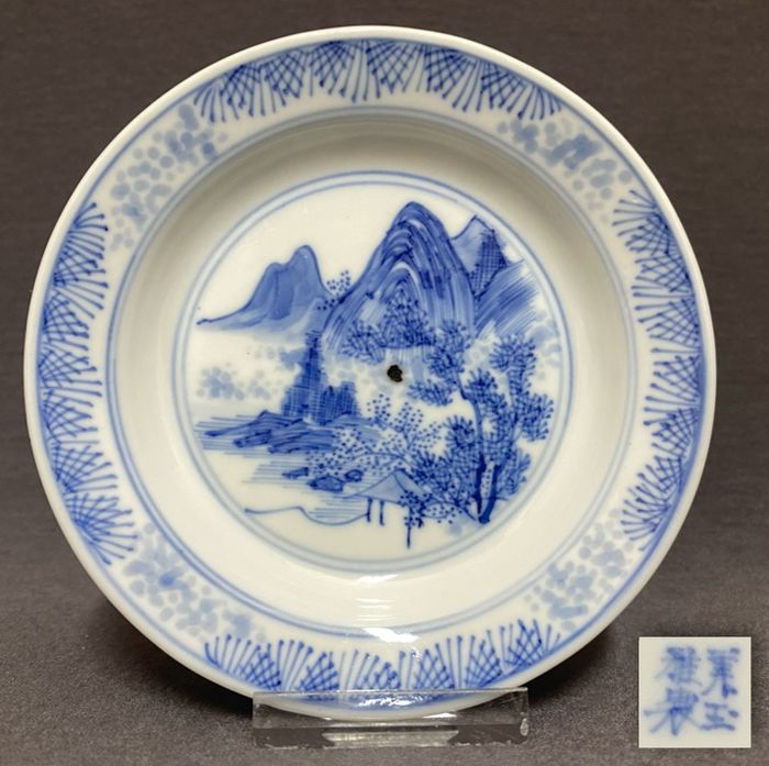 """Saucer - Porcelain - Chinese - """"Master of the Rocks"""" - High rocks,gorges,trees,pine needles and blurry dots - Mei Yu Ya - China - Kangxi (1662-1722)"""