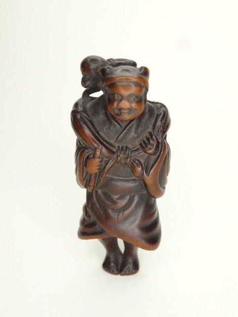 Netsuke (1) - Boxwood, Wood - Sarumawashi / Affentrainer - Japan - Edo Period (1600-1868)