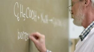 stock-footage-close-up-of-a-university-professor-writing-chemistry-equations-on-the-blackboard-during-a-lecture