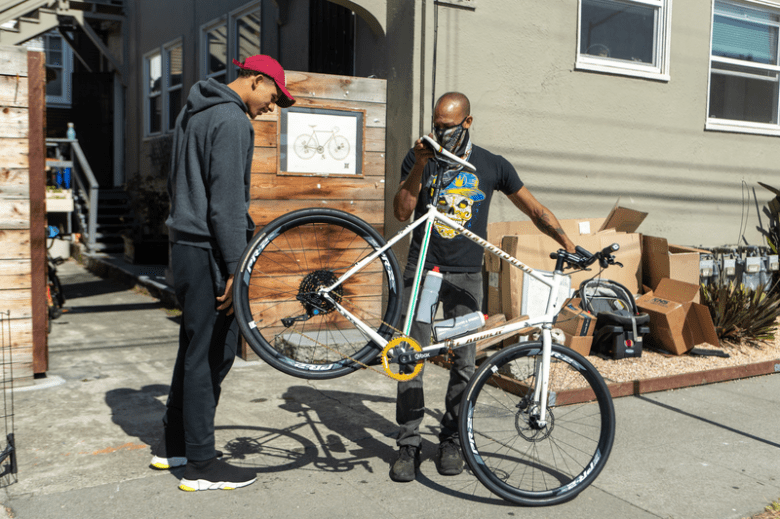 JTA and Towne Cycles shop owner going over the details of the bike.