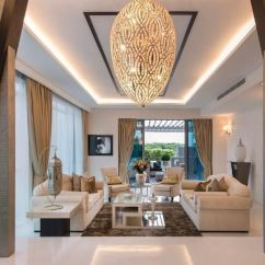 Lights For Living Room Singapore Orange Color Furniture Glam Contemporary Rooms In That We Love And Furnishings Play Second Fiddle To The Showstopping Light Fixture This High Ceilinged While Placement Of Pillars Cleverly