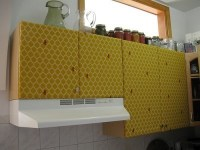 Cheerful Kitchen Makeover with Fabric Covered Cabinets ...