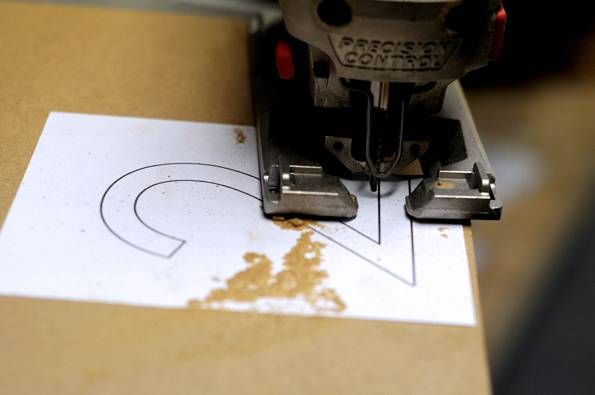 print out a template and use a jig saw to cut the numbers out
