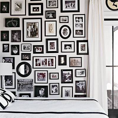 gallery wall of black and white framed photographs