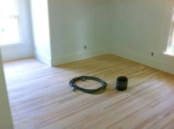 The bedroom, after the floors were sanded