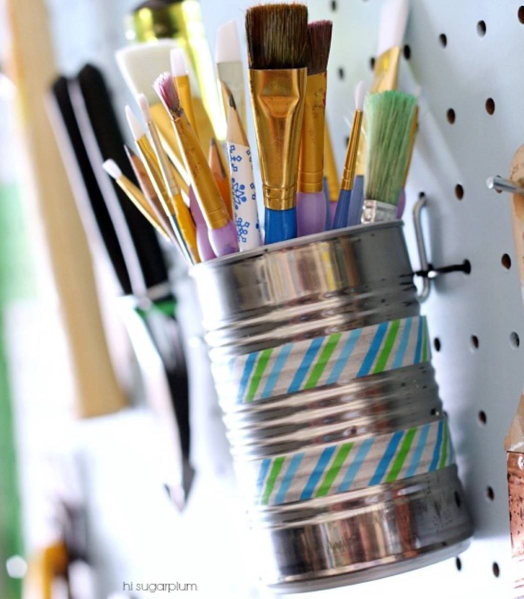 Use tin cans to organize supplies | 72 Organization Tips and Projects for Every Space in Your Home